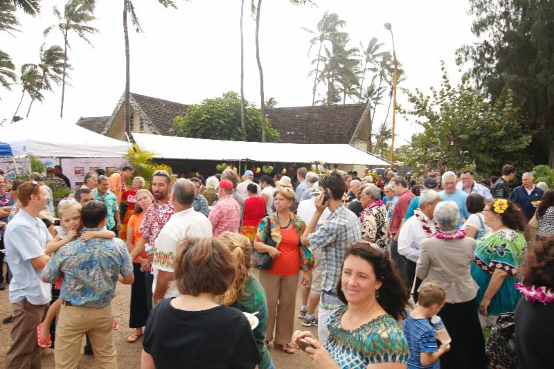 Groundbreaking crowd eats and mingles after event