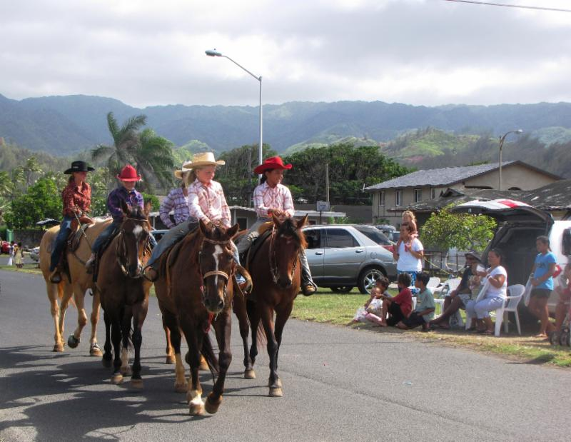 Residents enjoy the parade in Laie