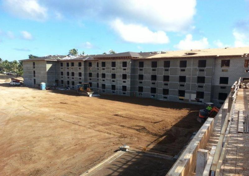 View of future pool and courtyard area (note palm trees rising over hotel roof)