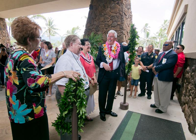 The Uchtdorfs and the Woods untied the maile lei at the hotel front entrance
