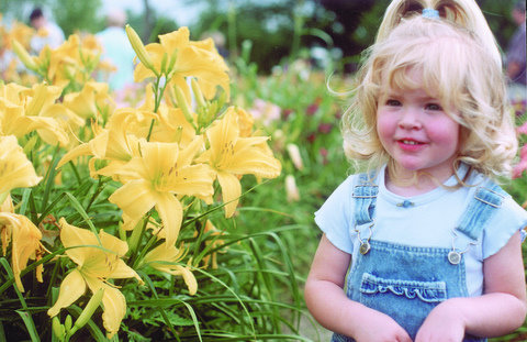 Girl with daylilies