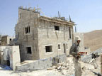 House being built in a Jewish West Bank settlement (UPI)