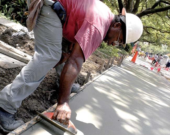 Worker installing sidewalk