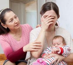 Depressed new mother receives comfort.
