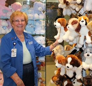 Barb Liddiard, Chair of the Volunteer Services Gift Shop, is surrounded by a wide selection of popular plush toys from the General site's Gift Shop.