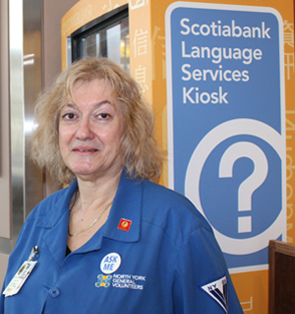 Alexandra Boutros is proud to wear the blue jacket of the North York General Hospital Volunteers.