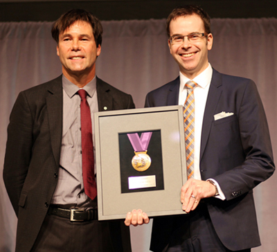 Dr. Jeremy Theal, right, Chief Medical Information Officer and Gastroenterologist at NYGH, is presented with the Minister's Medal Honouring Excellence in Health Quality and Safety by the Hon. Dr. Eric Hoskins, Minister of Health and Long-Term Care.