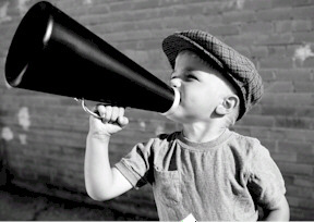 vintage photo of boy using megaphone