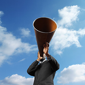 Photo of a man speaking into a megaphone