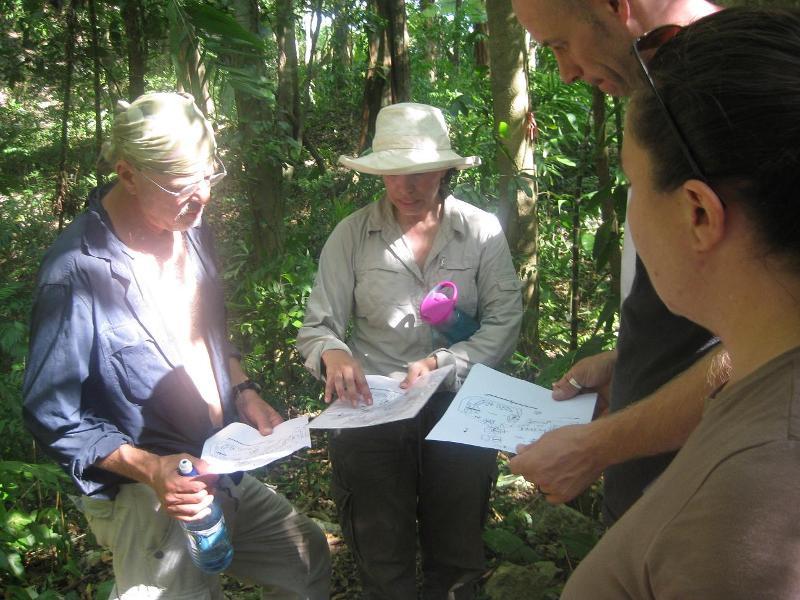 Dr Lisa Lucero explaining map of Yalbac Maya site near Cara Blanca Pools