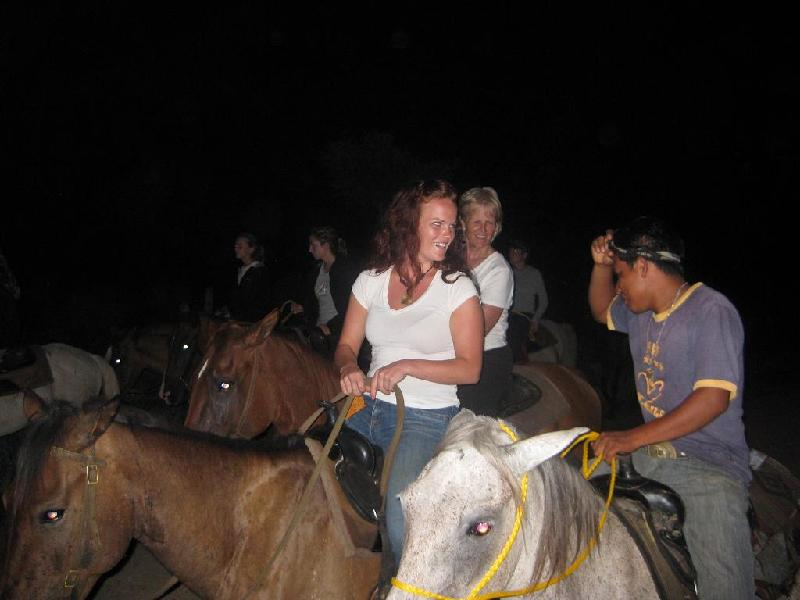 Guests enjoying conversation with Cesar - head cowboy - on Moonlight ride