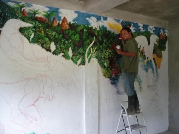 Giovanni Paolo Cenna Carr painting a mural