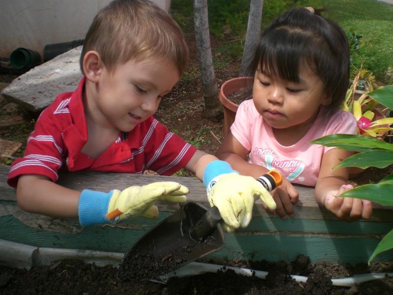 Children gardening in the Children_s Discovery Garden
