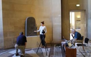 Kyle McCarter and Heather Parker photographing the Mesha Stele at the Louvre Museum, assisted by Bruce Zuckerman, June 2015