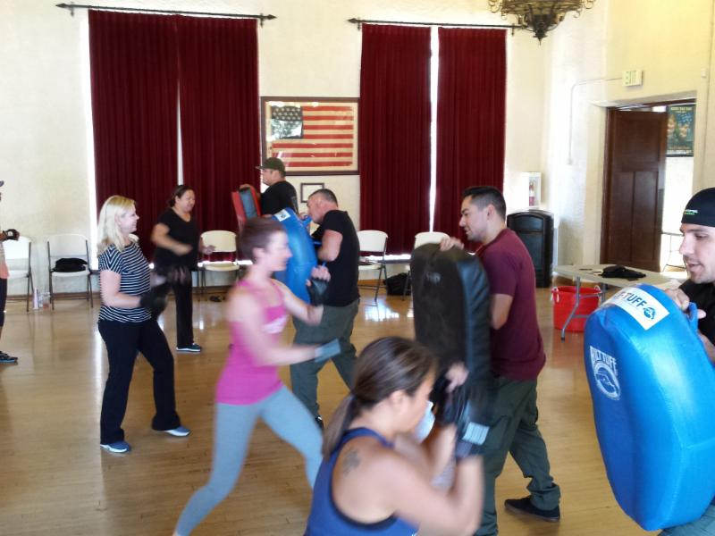Picture of Women Practicing punching at a previous self-defense class