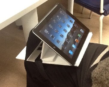 Photo of Dr Wilkomm's iPad stand holding an iPad to a thigh with Velcro One-Wrap.
