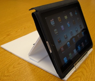 Photo of an iPad in a homemade stand constructed of corrugated plastic board.