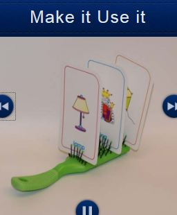 Photo of a hairbrush holding up three playing cards as an example of Make It Use It.