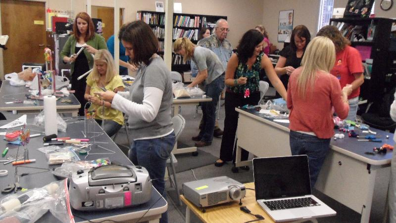 Photo showing workshop participants making adapted music solutions.