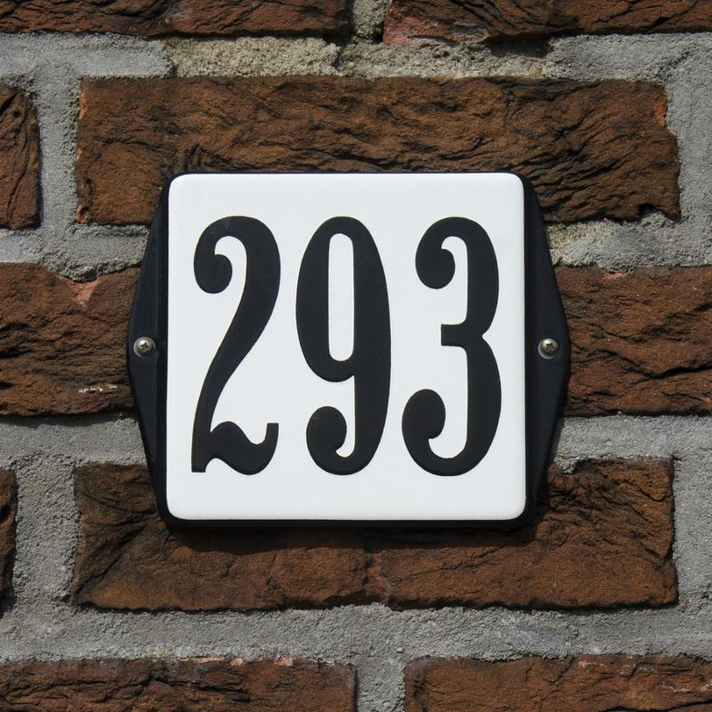 enameled house number two hundred and ninety-three. black lettering on a white background