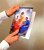 Hands holding Passion greeting card