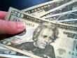 hand giving $20 bill