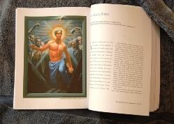 Passion book open to Jesus Rises