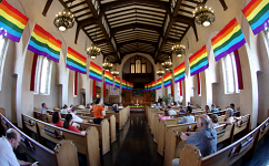 Rainbow Flags in church by Jim Ross