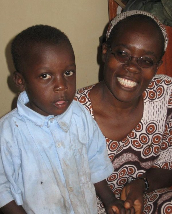 Sister with young student in Malava