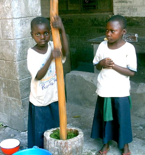 Kids pounding greens in Congo
