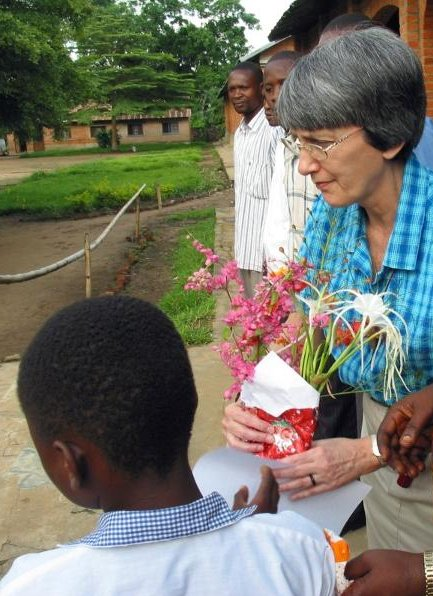 Sister Lorraine accepting flowers in Lemfu