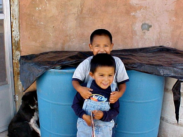 Navajo school children & water barrels