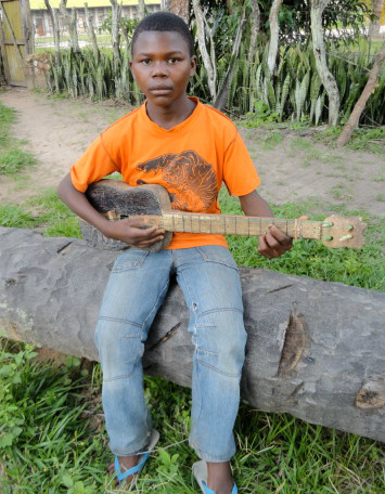 Young Decision holding guitar in Congo