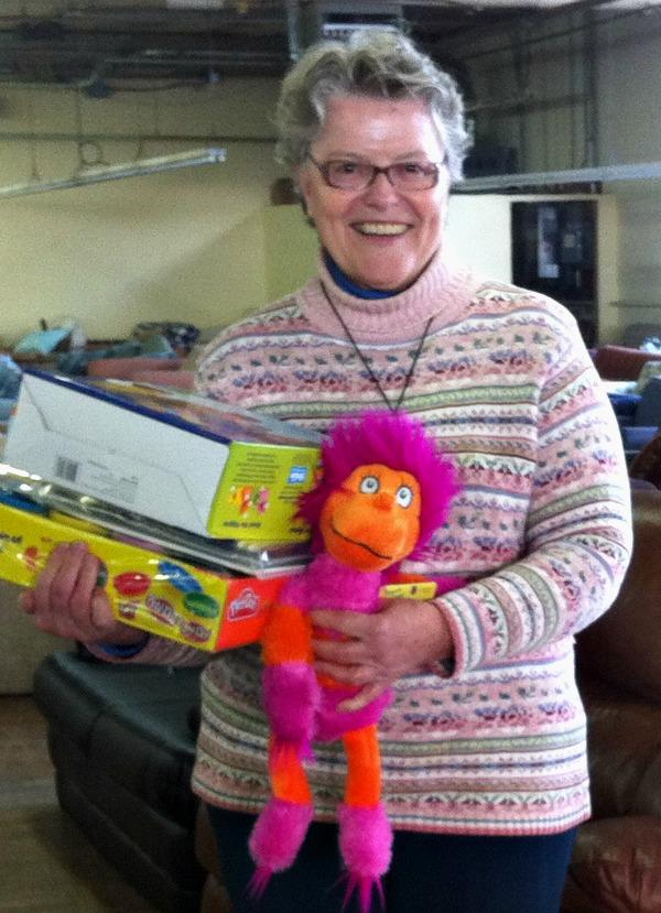 Sister Linda Bessom holding toys