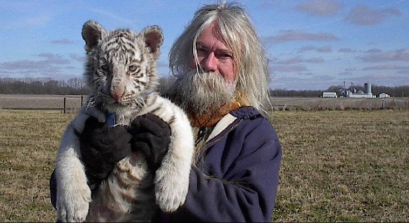 Dennis and white tiger cub