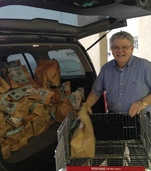 Volunteers unload Kroger donations