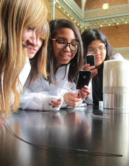Girls taking photos of an experiment