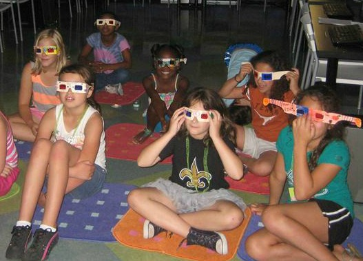 Group of girls wearing 3D glasses.