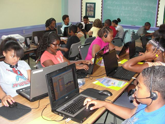Youth using Architect design software on laptops.