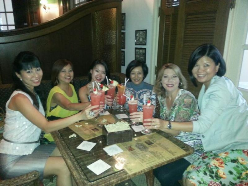 Enjoying a Singapore Sling at the famous Raffles Hotel.