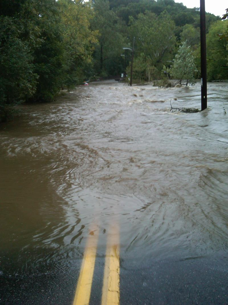 The Chester Creek overflows its banks during a nor'easter on October 1, marking the end of Mount Alverno Road for drivers in Aston, Pennsylvania.