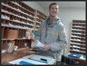 Individual working in a mailroom.