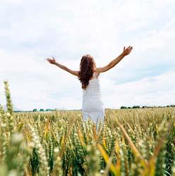 Praying woman in field