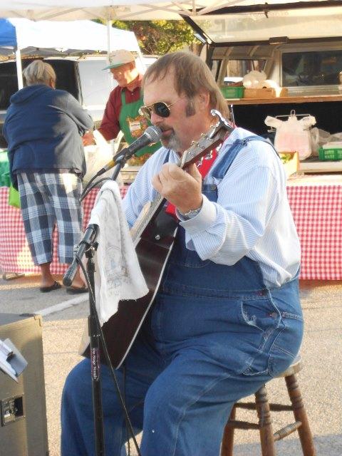 Musician, Bil Ihling entertains at a September market.