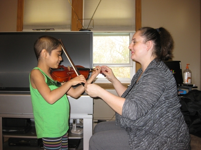 Amelie with violin teacher Emilia Small