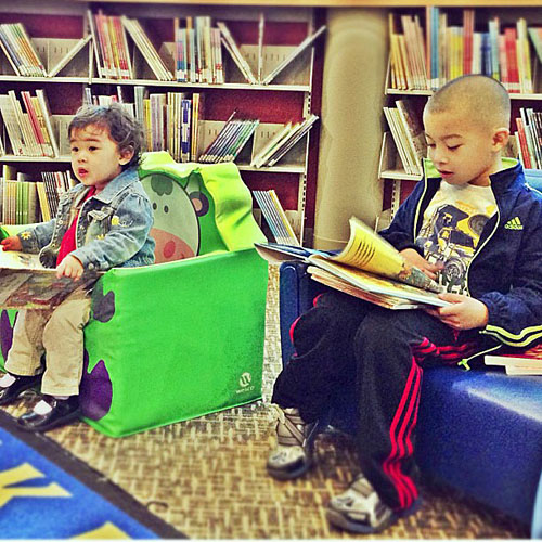 Kids reading at the library.