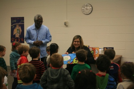 Lib Board Member Jeanette Cotter reads to children at Little Falls Library