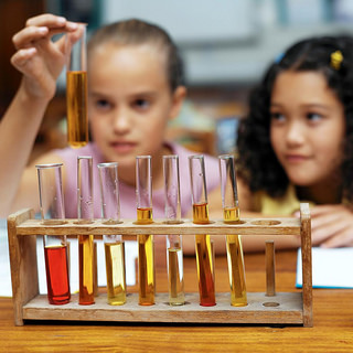 Girls performing a chemistry experiment.