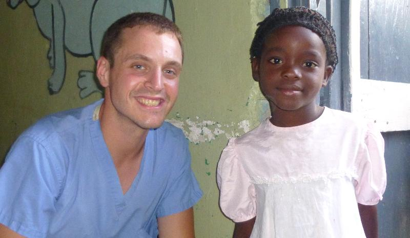 Jimmy Deom and patient.VOSH trip Oct 2012