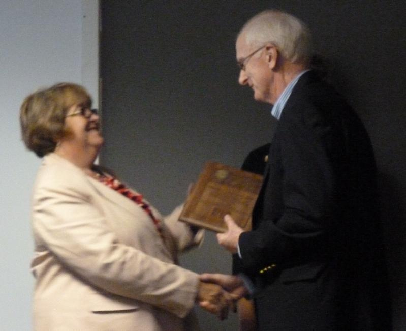 Dr Lewis receiving award from POA President Sept 2012